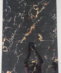 Gạch bóng kiếng trung quốc 60x120 đen vân cam